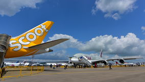 Qatar Airways A380 super jumbo behind the Scoot Boeing 787 Dreamliner at Singapore Airshow Royalty Free Stock Images