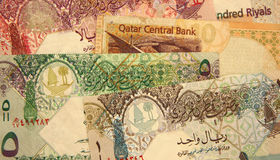 Qatar currency. Banknotes of 1, 5, 10, 50 and 100 Qatari Riyals stock photography
