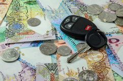 Qatar currency with car key Royalty Free Stock Photo