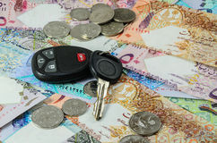 Qatar currency with car key Stock Photography