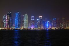 Financial centre in Doha city at night, Qatar. QATAR, DOHA, MARCH 20, 2018: Night financial centre in Doha - capital and most populous city in Qatar. View on stock images