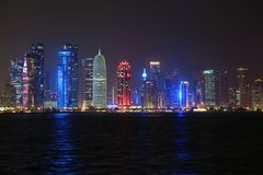 Financial centre in Doha city at night, Qatar. QATAR, DOHA, MARCH 20, 2018: Night financial centre in Doha - capital and most populous city in Qatar. View on stock photography
