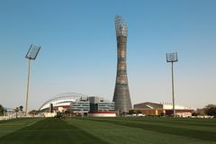 Torch tower and football stadiums in Doha Sports City, Qatar. QATAR, DOHA, MARCH 26, 2018: The Torch Doha or Torch tower, also known as Aspire Tower, football stock images