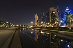 Qatar doha at night. Qatar doha cornice at night beautiful water reflection of the buildings Royalty Free Stock Image