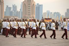 Qatar Emiri Guards. DOHA-QATAR: DECEMBER 18: Qatar Emiri Guards are performing military marches in Doha, Qatar. The event was held on Qatar National Day on the stock photos