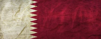 Qatar Flag on Paper. Flag on an old Paper Texture Royalty Free Stock Photos
