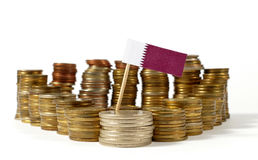 Qatar flag with stack of money coins Royalty Free Stock Photo