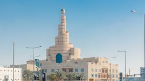 Qatar Islamic Cultural Centre timelapse in Doha, Qatar, Middle-East. Traffic on the road. Blue sky at sunny day stock footage