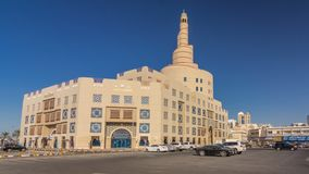 Qatar Islamic Cultural Centre timelapse hyperlapse in Doha, Qatar, Middle-East. Traffic on the road. Blue sky at sunny day stock video