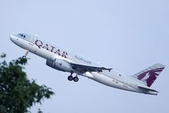 Qatar Airways Plane flying to exotic destinations stock images