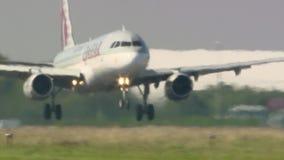 Boeing 737 Qatar landing in Otopeni Bucharest stock footage