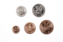 Qatari coins on a white background. Dirham Royalty Free Stock Image