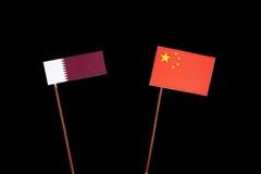 Qatari flag with Chinese flag on black. Background royalty free stock photos
