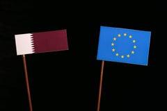Qatari flag with European Union EU flag  on black. Background Royalty Free Stock Photo