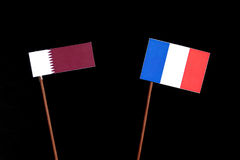 Qatari flag with French flag isolated on black Royalty Free Stock Images
