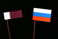 Qatari flag with Russian flag on black. Background stock images