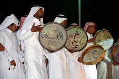 Qatari folk drummers. A qatari folk troupe performing at the Heritage Village on Doha Corniche during the Doha Cultural Festival, February/March 2008 Royalty Free Stock Image