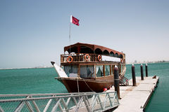Qatari pleasure dhow. A large dhow, or boom, flying the Qatari flag, which is used for pleasure trips around Doha Bay, Qatar Royalty Free Stock Photography