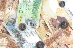 Qatari riyals currency bills and coins as a background. The State of Qatar currency bills and coins scattered as a background Stock Images