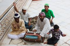 Qawwali singers at the Tomb of Sheikh Salim Chishti. Qawwali is a form of Sufi devotional music popular in South Asia: in the Punjab and Sindh regions of stock photography
