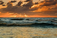 QE FI Beach rise sun rays Royalty Free Stock Photo