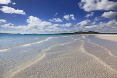 QE Whit Beach Waves. Whitesundays islands whitehaven beach coral reef national park queensland australia white beach with surfing waves summer day Royalty Free Stock Image