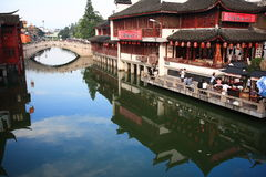 Qi Bao TOWN. In Shanghai , China, river, old building, bridge, blue sky reflection royalty free stock images