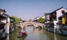 Qibao, Shanghai,China - April 7,2012:Qibao water village, boats in the main canal and an old bridge. Royalty Free Stock Photos