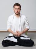 Qigong training. Meditation. Qigong. Meditation. Young man in sitting in lotus pose meditating Royalty Free Stock Photo