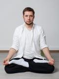Qigong training. Meditation. Qigong. Meditation. Young man in sitting in lotus pose meditating Stock Photo