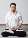 Qigong training. Meditation. Qigong. Meditation. Young man in sitting in lotus pose meditating Stock Images