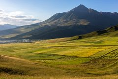 Qilian Niuxinshan illuminated by the sun in the morning royalty free stock image