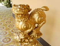 Qilin asian golden mythological statue. In the yard. Chinese and vietnam ancient mythological magic creature. a mythical hooved chimerical creature in Chinese royalty free stock image