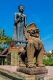 Qilin asian mythological statue in Thailand buddhist temple. Qilin asian mythological animal guard statue and Buddha in Thai Buddhist temple entrance, Thailand royalty free stock image