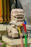 Qilin asian mythological statue in Thailand buddhist temple. Qilin asian mythological animal guard statue in Thai Buddhist temple entrance, Thailand royalty free stock photo