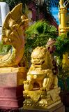 Qilin asian mythological statue in Thailand buddhist temple. Qilin asian mythological animal guard statue in Thai Buddhist temple entrance, Thailand stock images