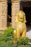 Qilin asian mythological statue in Thailand buddhist temple. Qilin asian mythological animal guard statue in Thai Buddhist temple entrance, Thailand royalty free stock images
