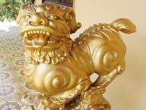 Qilin asian mythological golden statue. Qilin asian mythological statue in the yard. Chinese and vietnam ancient mythological magic creature. a mythical hooved stock image