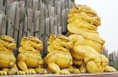 Qilin asian mythological golden statue. Qilin asian mythological statue in the yard. Chinese and vietnam ancient mythological magic creature. a mythical hooved stock images