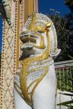 Qilin asian mythological guard statue in Thai temple. Qilin asian mythological guard statue in Thai Buddhist temple entrance, Thailand Royalty Free Stock Image