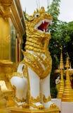 Qilin asian mythological guard statue in Thai temple. Qilin asian mythological guard statue in Thai Buddhist temple entrance, Thailand Stock Photos