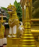 Qilin asian mythological guard statue in Thai temple. Qilin asian mythological guard statue in Thai Buddhist temple entrance, Thailand Stock Images