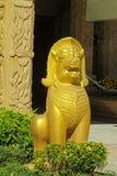 Qilin asian mythological guard statue in Thai temple. Qilin asian mythological guard statue in Thai Buddhist temple entrance, Thailand Stock Photo