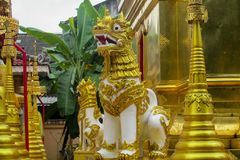 Qilin asian mythological guard statue in Thai temple. Qilin asian mythological guard statue in Thai Buddhist temple entrance, Thailand Royalty Free Stock Images