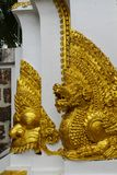 Qilin asian mythological guard statue in Thai temple. Qilin asian mythological guard statue in Thai Buddhist temple entrance, Thailand Royalty Free Stock Photography