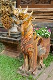 Qilin asian mythological guard statue in Thai temple. Qilin asian mythological guard statue in Thai Buddhist temple entrance, Thailand Royalty Free Stock Photo