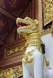 Qilin asian mythological guard statue in Thailand wat. Qilin asian mythological statue in the yard of Thailand wat thai buddhist temple near big stupa. Ancient Royalty Free Stock Image