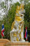 Qilin asian mythological guard statue in Thailand wat. Qilin asian mythological statue in the yard of Thailand wat thai buddhist temple near big stupa. Ancient Stock Image
