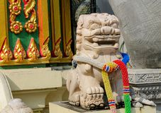 Qilin asian mythological guard statue in Thailand wat. Qilin asian mythological statue in the yard of Thailand wat thai buddhist temple near big stupa. Ancient Stock Photos