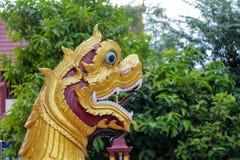 Qilin asian mythological guard statue in Thailand wat. Qilin asian mythological statue in the yard of Thailand wat thai buddhist temple near big stupa. Ancient Stock Photo